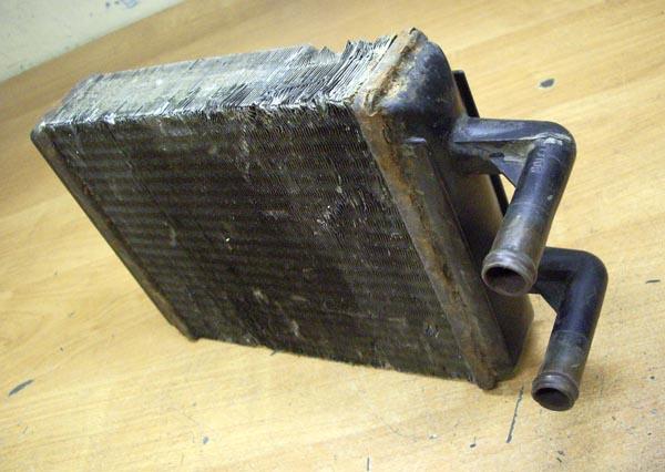 Загрязнившийся отопительный радиатор